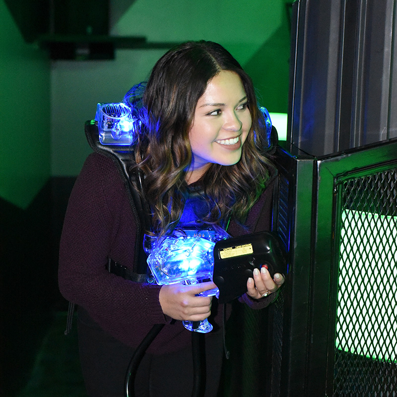 Boondocks - Woman Playing Laser Tag