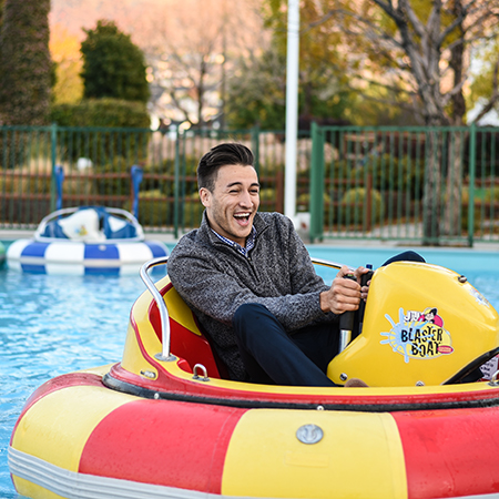 Boondocks - Man Riding Bumper Boat